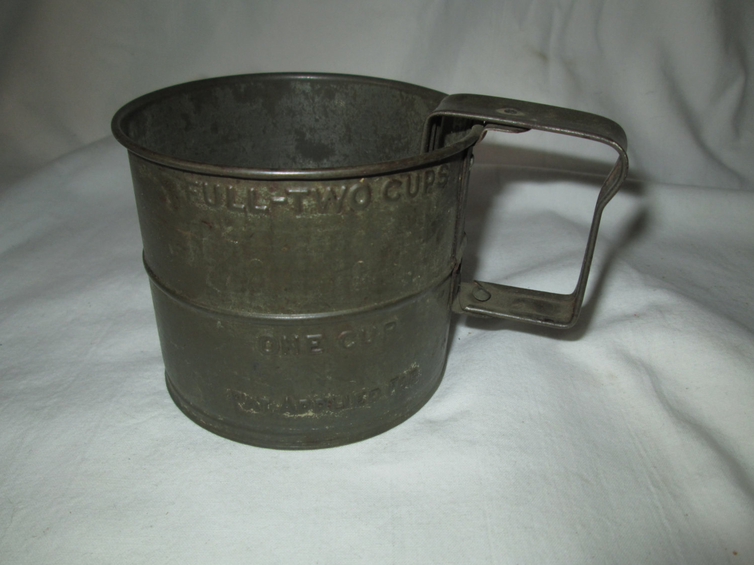 A fantastic primitive flour sifter great decor