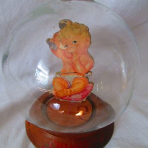 Antique Vic Moran Bubble Bank Glass with Change for the baby and a pink Baby Girl Pillow