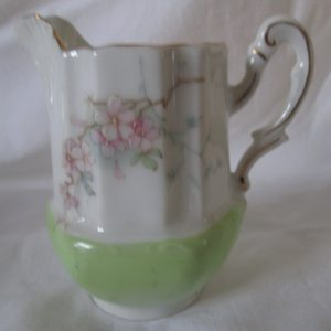 Beautiful Antique Cream Pitcher Pink Flowers raised scrolls top and handle trimmed in gold Apple green base white top