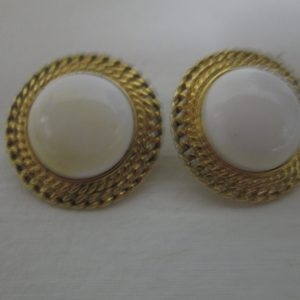 Beautiful Gold tone earrings with white centers Gold trim pierced edges