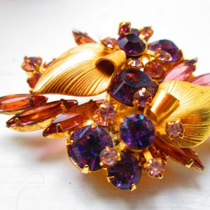 Beautiful Gold tone with amethyst color and lavender rhinestones leaves and flowers pattern