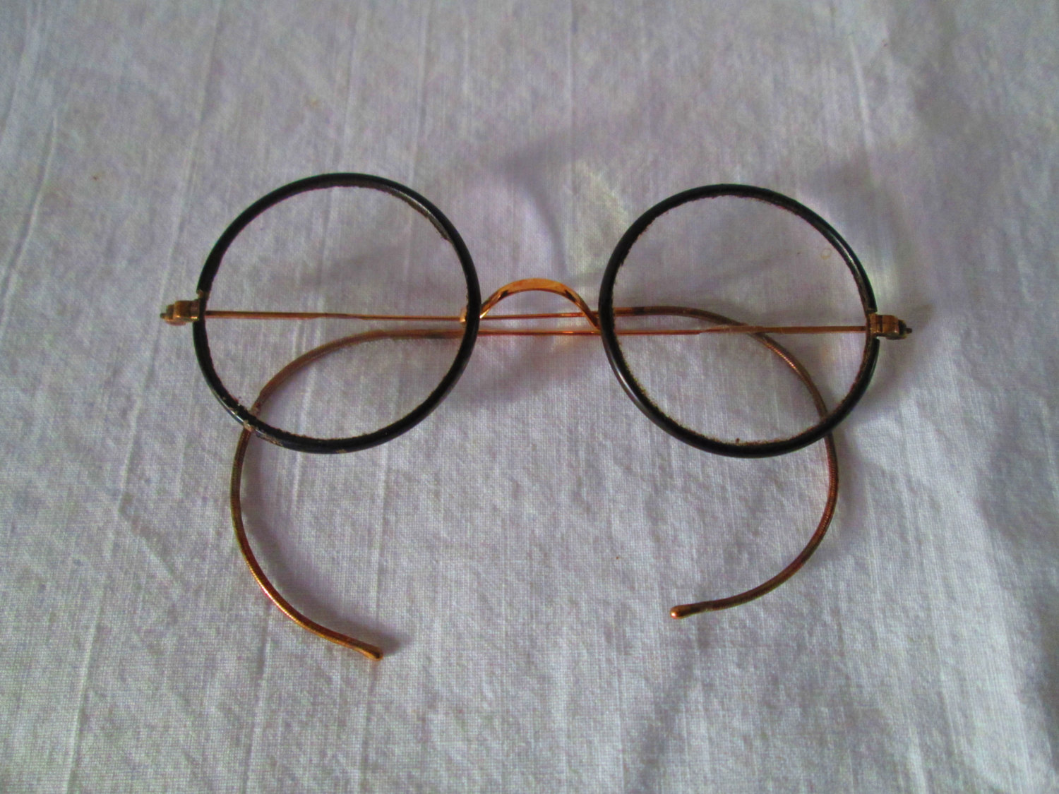 Pair of Wire Rim Eye Glasses with black bakelite around lenses early ...