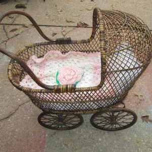 Vintage All wicker Baby Doll Bear Buggy rolls works great nice condition with hand knitted blanket with rose center