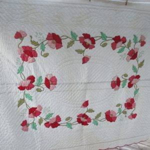 Vintage Hand sewn applique quilt Red and Pink Flowers Stunning design white backing lined  72x86
