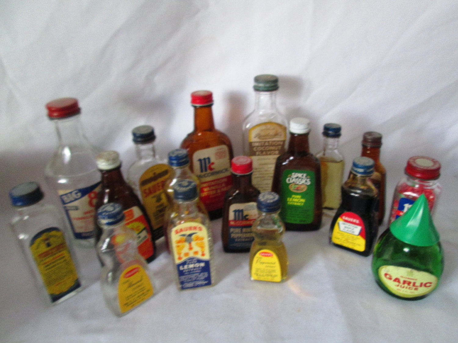 Vintage Lot of 17 glass bottles of extracts flavoring Sauer's McCormick Ann  Page Rawleigh's 1930's-