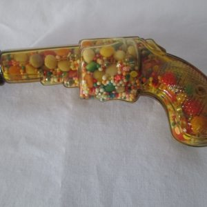 Vintage toy glass gun with original candy inside & original red metal cap Amber glass No Damaage Rare Color candy dispenser