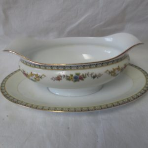 "Beautiful Noritake Japan Mid Century Fine Bone China Floral Pattern Gravy Boat plate with small chip on bottom rim 9"" long 7"" wide"