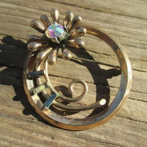 Beautiful Rhinestone round pin gold metal aurora boralis flower center with blue and clear bagettes vintage jewelry