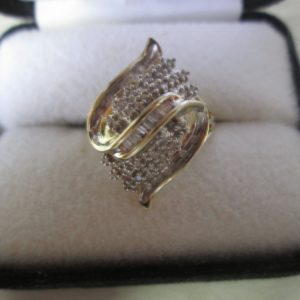 Beautiful Vintage Diamond Cocktail Ring 10Kt Gold with diamonds and baguettes