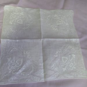 Beautiful white on white hankie embroidered appliquéd with lace pattern