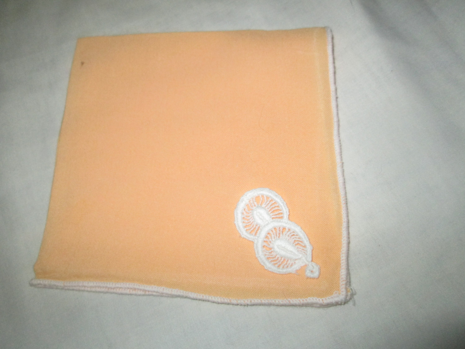 Pretty Pale Orange Color Handkerchief With Small White Lique Circles And Whtie Trimmed Edge