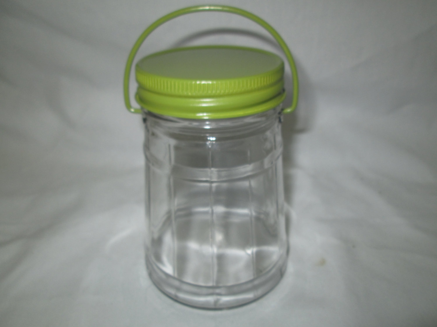 Vintage glass pickle jar with green metal lid and bail wire handle ribbed glass collectibles marbles dog cat treats buttons display storage