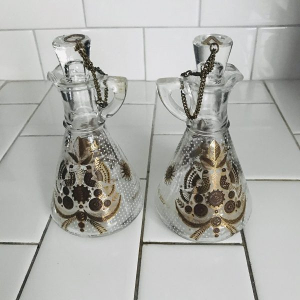 Vinegar and Oil Bottles 1950's chain to lids folk art pattern with white dots between metal O and V on lids clear Hazel Atlas Glass